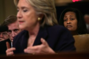 Democratic presidential candidate and former Secretary of State Hillary Clinton testifies before the House Select Committee on Benghazi as Jake Sullivan, left, Clinton's top foreign policy campaign adviser and her deputy chief of staff at the State Department, and Cheryl Mills, right, Clinton's chief of staff at the State Department, look on Oct. 22, 2015. (Credit: Alex Wong/Getty Images)