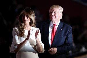 Republican presidential candidate Donald Trump and his wife Melania Trump acknowledge the crowd on the fourth day of the Republican National Convention on July 21, 2016, in Cleveland, Ohio. (Credit: Win McNamee/Getty Images)