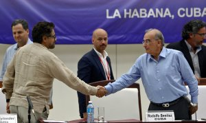 The head of the Colombian government delegation to the peace talks with the FARC leftist guerrillas shake hands during a press conference at Convention Palace in Havana, on Aug. 5, 2016. (Credit: YAMIL LAGE/AFP/Getty Images)