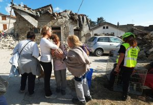 Women cry in front of damaged houses in a street in the central Italian village of Illica, near Accumoli, on Aug. 24, 2016 after a powerful earthquake rocked central Italy leaving at least 159 dead and hundreds more injured. (Credit: Mario Laporta/Getty Images)