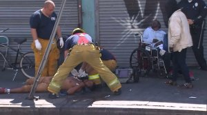 Los Angeles firefighters respond to a presumed overdose, treated one of 18 patients assessed, in Skid Row on Aug. 22, 2016. (Credit: KTLA)
