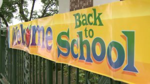 A welcome back to school sign greeted returning students outside an LAUSD school. (Credit: KTLA)
