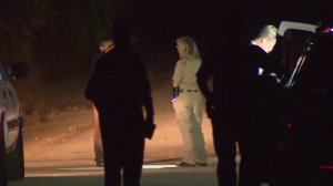 Homicide investigators are seen in Lebec after a woman's body was discovered on Aug. 14, 2016. (Credit: KTLA)
