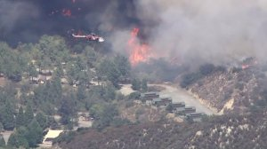 Structures in the Lytle Creek area were threatened by flames on Aug. 17, 2016. (Credit: KTLA)