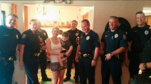 Terra Hubbard and her son Brayden pose with Yukon Police officers on Aug. 9, 2016. (Credit: KFOR)