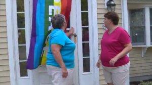 A Massachusetts community rallied behind a gay couple who had their pride rainbow flag stolen from their house. (Credit: WCVB via CNN)