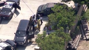 Paramedics treat one person after an officer-involved shooting in Lawndale on Aug. 2, 2016. (Credit: KTLA)