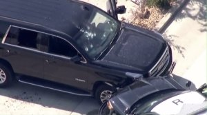Multiple gunshot holes are seen in an SUV that crashed into a police SUV, prompting an officer-involved shooting in Lawndale on Aug. 2, 2016. (Credit: KTLA)