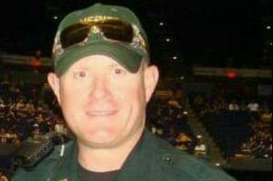 East Baton rouge Parish Sheriff's deputy Nicholas Tullier, 41, helped change a woman's flat tire night before he was shot on July 17, 2016. Tullier survived the attack that killed three other officers. (Credit: Gofundme)