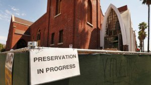 The removal of stained glass from a church being converted to creative offices has angered neighborhood activists in Hollywood. (Credit: Al Seib/Los Angeles Times)
