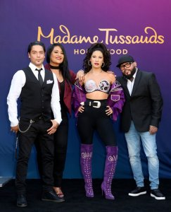 Selena's former husband Chris Perez (left), sister Suzette Quintanilla (second left), and brother A.B. Quintanilla (right) during Madame Tussauds Hollywood's unveiling Selena's wax figure on Aug. 30, 2016. (Credit: Rachel Murray/Getty Images for Madame Tussauds Hollywood)