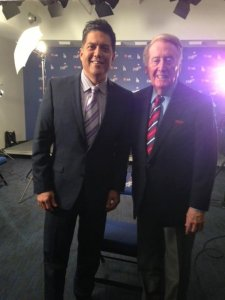 Frank Buckley and Vin Scully pose for a photo in December 2013.