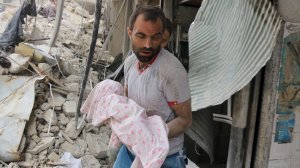 A Syrian man carries the body of an infant retrieved from under the rubble of a building following a reported airstrike on September 23, 2016, in the northern Syrian city of Aleppo. (Credit: Thaer Mohammed/AFP/Getty Images)