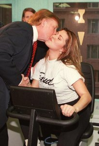 Miss Universe, Venezuela's Alicia Machado, kisses Donald Trump, owner of the Miss Universe pageant, on Jan. 28, 1997, during her daily fitness workout at a health center in New York. (Credit: JON LEVY/AFP/Getty Images)