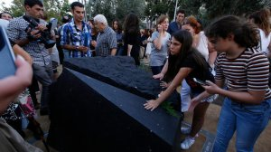 Melani Nazarian, left, and Ashley Muradian view the first permanent monument in L.A. to memorialize the Armenian genocide after it was unveiled at Grand Park. (Credit: Glenn Koenig/Los Angeles Times)