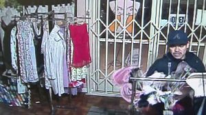 A man caught on surveillance video burglarizing a lingerie store is believed to be connected to at least 18 other incidents in the San Fernando Valley. (Credit: LAPD)