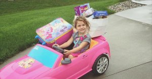 A Facebook photo shows Becca VanZyll of Hudsonville Michigan with toys loaded in her Barbie car for neighbors who lost everything in a fire.