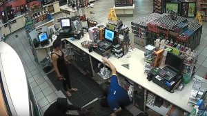 Surveillance video shows two people robbing a cashier at an Arco gas station in Compton on Sept. 22, 2016.