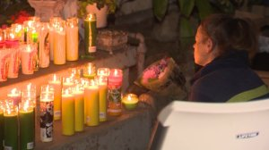 A vigil was held Sept. 25, 2016, at a Fullerton home where three people were found dead the previous day. (Credit: KTLA)