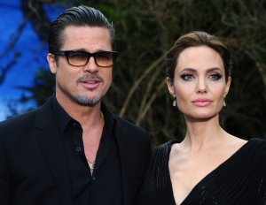 Brad Pitt and Angelina Jolie attend a private reception on May 8, 2014 in London, England. (Credit: Anthony Harvey/Getty Images)