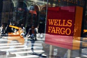 Pedestrians pass a Wells Fargo bank branch in lower Manhattan on April 15, 2016, in New York City. (Credit: Spencer Platt/Getty Images)