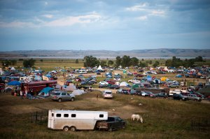 People gather at an encampment to support the Standing Rock Sioux Tribe's protest against the construction of the Dakota Access Pipe, near Cannon Ball, North Dakota, on Sept. 3, 2016. (Credit: ROBYN BECK/AFP/Getty Images)