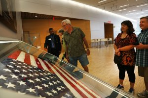 The American flag that was raised by firefighters above the site of the 9/11 attacks on the World Trade Center in New York on 2001 is displayed for the first time at the National September 11 Memorial & Museum after turning up in Washington state two years ago on September 8, 2016 in New York City. (Credit: Spencer Platt/Getty Images)