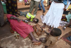 Victims of the earthquake measured 5.7 magnitude which struck the countrys Lake Zone lie on the ground at the Bukoba Referral Hospital for treatment, on September 10, 2016. (Credit: STR/AFP/Getty Images)