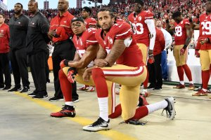 Colin Kaepernick and Eric Reid of the San Francisco 49ers kneel in protest during the national anthem prior to playing the Los Angeles Rams in their NFL game at Levi's Stadium on Sept. 12, 2016, in Santa Clara, California. (Credit: Thearon W. Henderson/Getty Images)