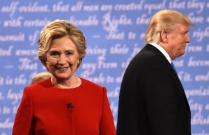 Democratic nominee Hillary Clinton and Republican nominee Donald Trump leave the stage after the first presidential debate at Hofstra University in Hempstead, New York, on Sept. 26, 2016. (Credit: TIMOTHY A. CLARY/AFP/Getty Images)