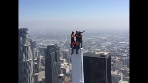 Construction workers take a picture on top of the Grand Wilshire Tower as it becomes the tallest building on the West Coast on Sept. 3, 2016. (Credit:KTLA)