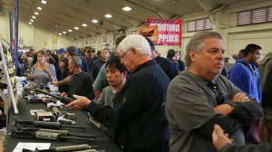 Gun enthusiasts view AR-15 semiautomatic assault rifle upper receiver parts and kits, which are legal in California, at the Crossroads of the West Gun Show in Del Mar. (Credit: Allen J. Schaben/Los Angeles Times)