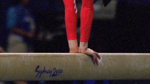 A U.S. gymnast performs on the balance beam during the 2000 Olympics in Sydney, Australia. (Credit: Mike Powell /Getty Images)