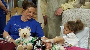 Natasha Fuller with her teacher Jodi Schmidt, left, who donated a kidney to the second grader. (Credit: CNN)