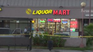 A store clerk was killed early Sunday following a shooting inside A & D Liquor Mart in North Hollywood. (Credit: KTLA)