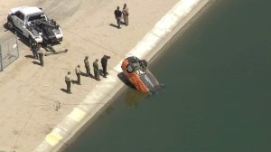 Authorities pull a car from the California Aqueduct in the Littlerock area on Sept. 9, 2016. (Credit: KTLA)