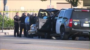 Long Beach police officers were investigating an officer-involved shooting in Long Beach on Sept. 11, 2016. (Credit:KTLA)