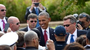 President Barack Obama greets attendees during a ceremony commemorating the September 11, 2001 attacks at the Pentagon in Washington, DC, on September 11, 2016. (Credit: Jose Luis Magana/AFP/Getty Images)