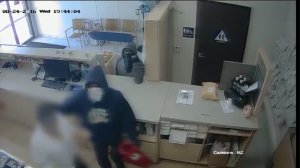 Surveillance video released by LAPD shows two suspects wanted in the armed robbery of a pharmacy on Aug. 24, 2016. (Credit: LAPD)