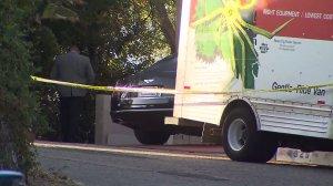 Police investigate a fatal shooting in Woodland Hills on Sept. 14, 2016. (Credit: KTLA)