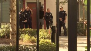 "Pasadena officers stand at the scene of a ""death investigation"" on Sept. 30, 2016. (Credit: KTLA)"