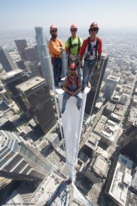 Construction workers pose in a photo from atop a spire 1,099 feet above the ground in downtown L.A. on Sept. 3, 2016. (Credit: Gary Leonard/Wilshire Grand)