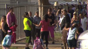 Parents and children stand near Indian Hills Elementary on Sept. 6, 2016. (Credit: KTLA)