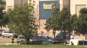 Two good Samaritans risked their lives to save a mom and her baby when they were attacked outside a Wal-Mart in Shawnee, Kansas. (Credit: WDAF)