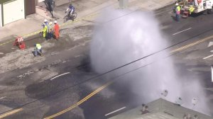 Water gushed onto Western Avenue after a main broke in South L.A. on Sept. 7, 2016. (Credit: KTLA)