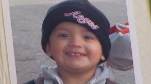 Yonatan Daniel Aguilar, 11, is seen in a family photo album shown at his public memorial on Sept. 14, 2016 in Echo Park. (Credit: KTLA)