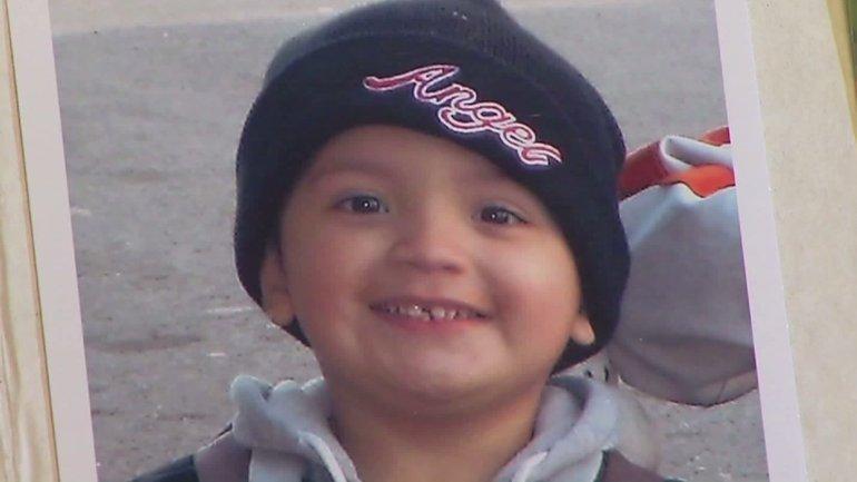 Yonatan Daniel Aguilar is seen in a family photo album shown at his public memorial on Sept. 14, 2016 in Echo Park. (Credit: KTLA)