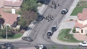 Authorities respond in Lancaster after a sergeant was shot on Oct. 5, 2016. (Credit: KTLA)