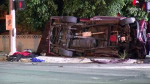 A red pick up truck remains on its side at the scene of a double fatal hit-and-run crash in Chatsworth on Oct. 7, 2016. (Credit: OnScene.TV)