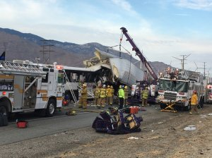 Authorities respond to a deadly crash between a big rig and a tour bus on Oct. 23, 2016 in Desert Hot Springs. (Credit: Chris Tarpening/KESQ)